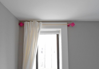Curtain brace and finial